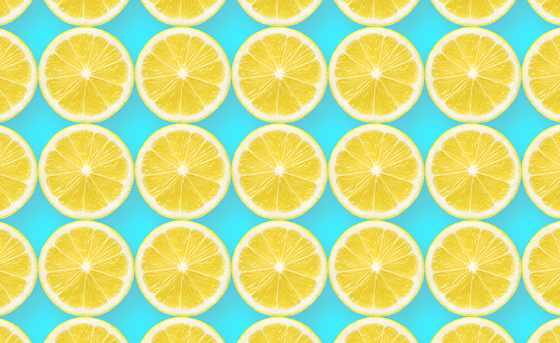 Rows of lemon slices against a light blue backdrop.