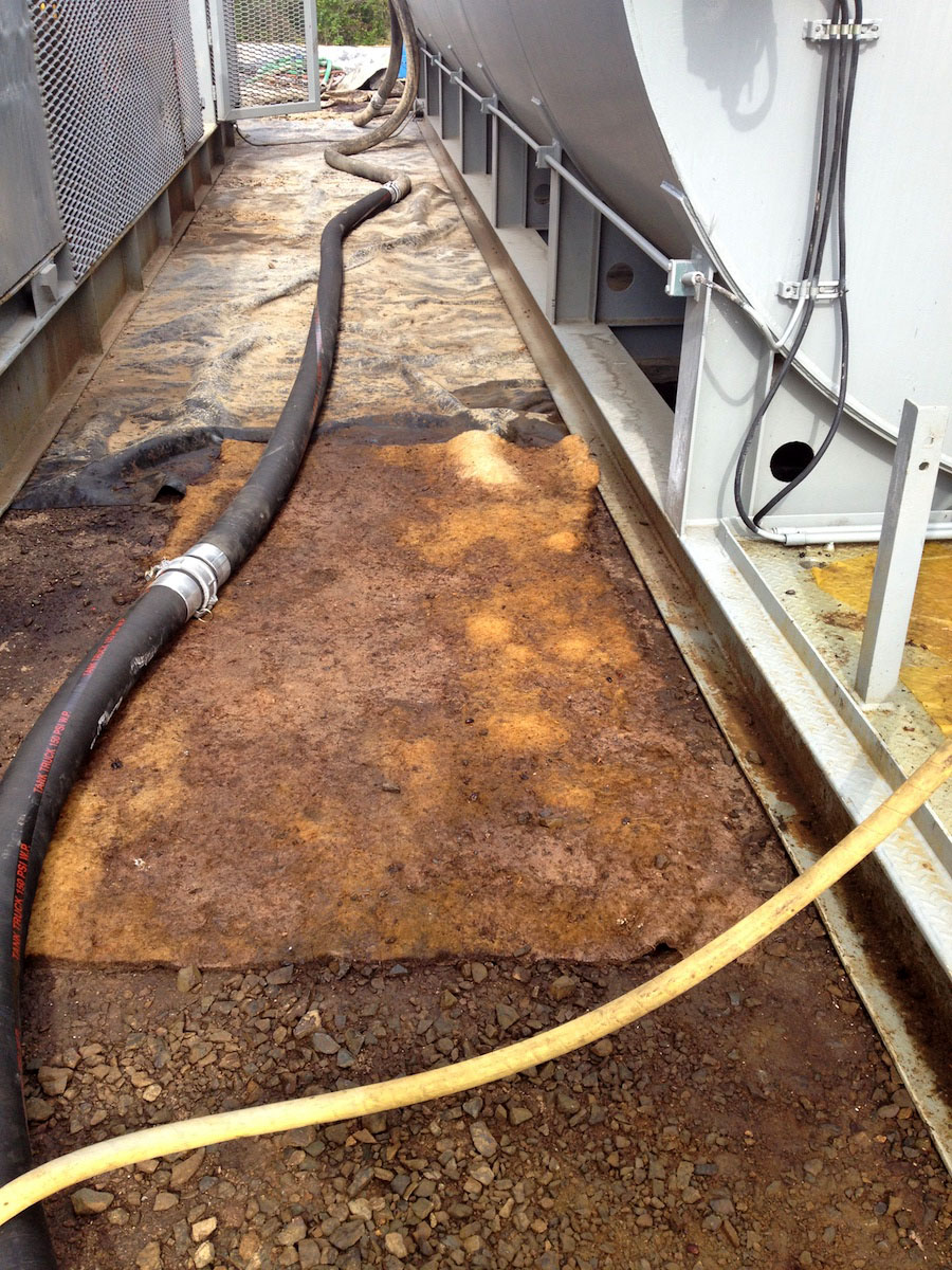 Kengro Biopad absorbent pad being used for floor safety to absorb oil from a leaking pipe