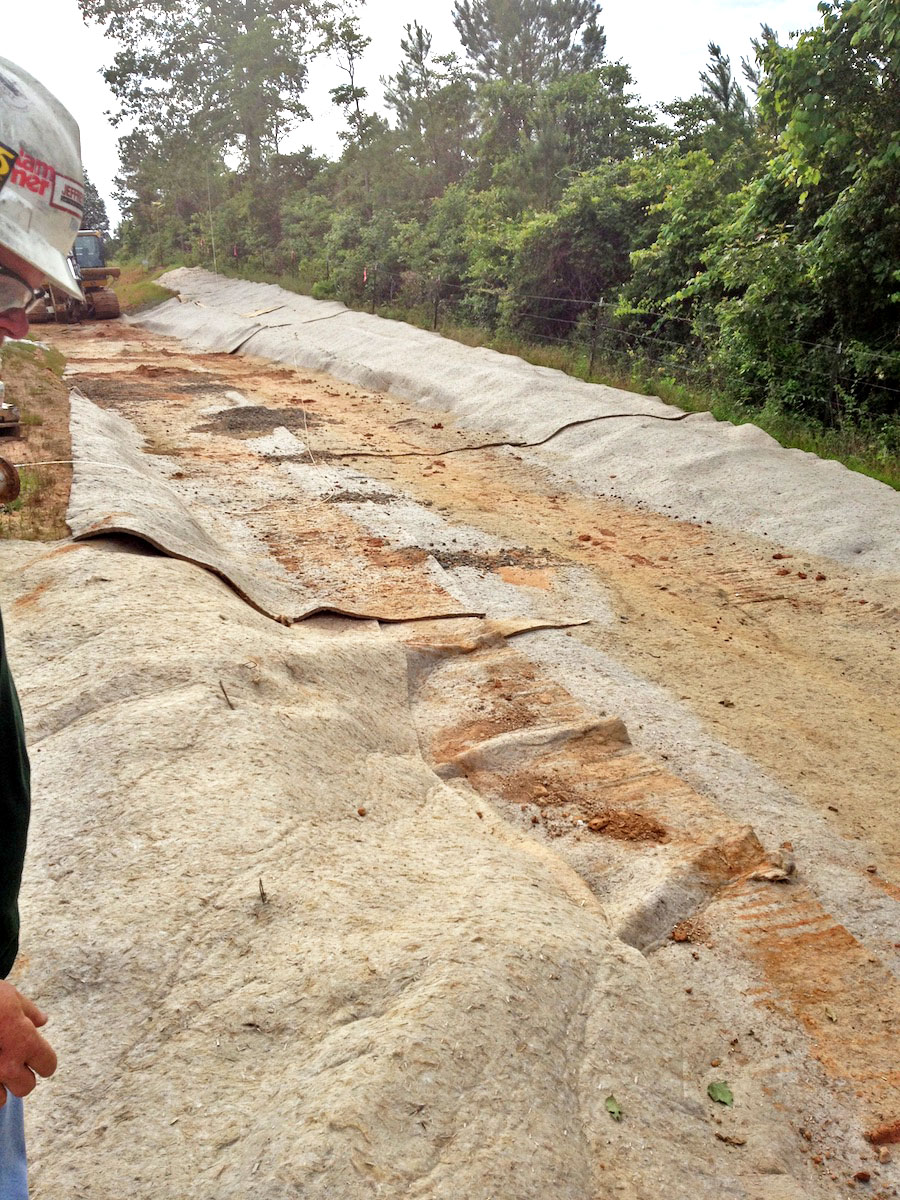 Kengro Biopad reinforcement mat being used on a hillside for erosion control