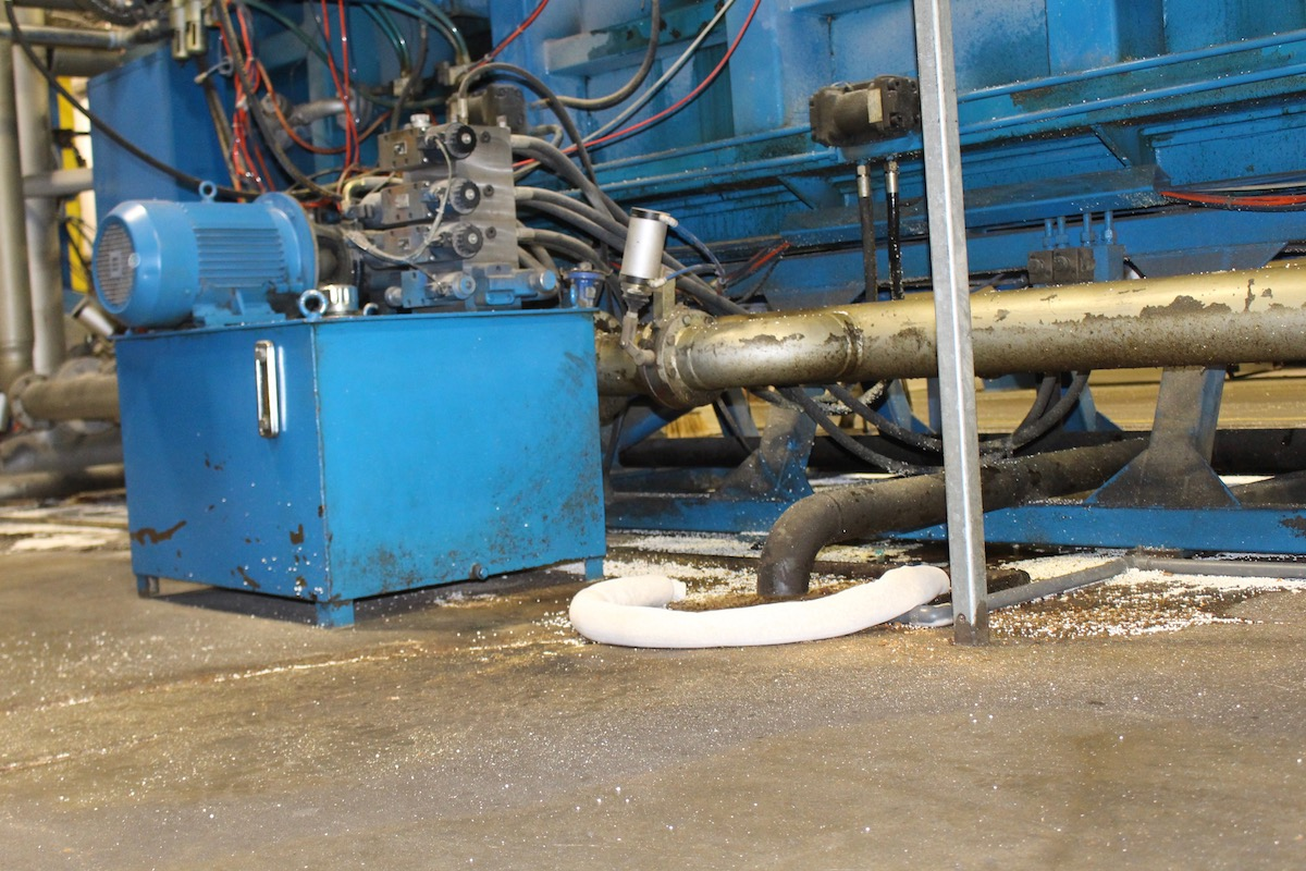 Biosorb oil absorbent sock cleaning a spill in a factory