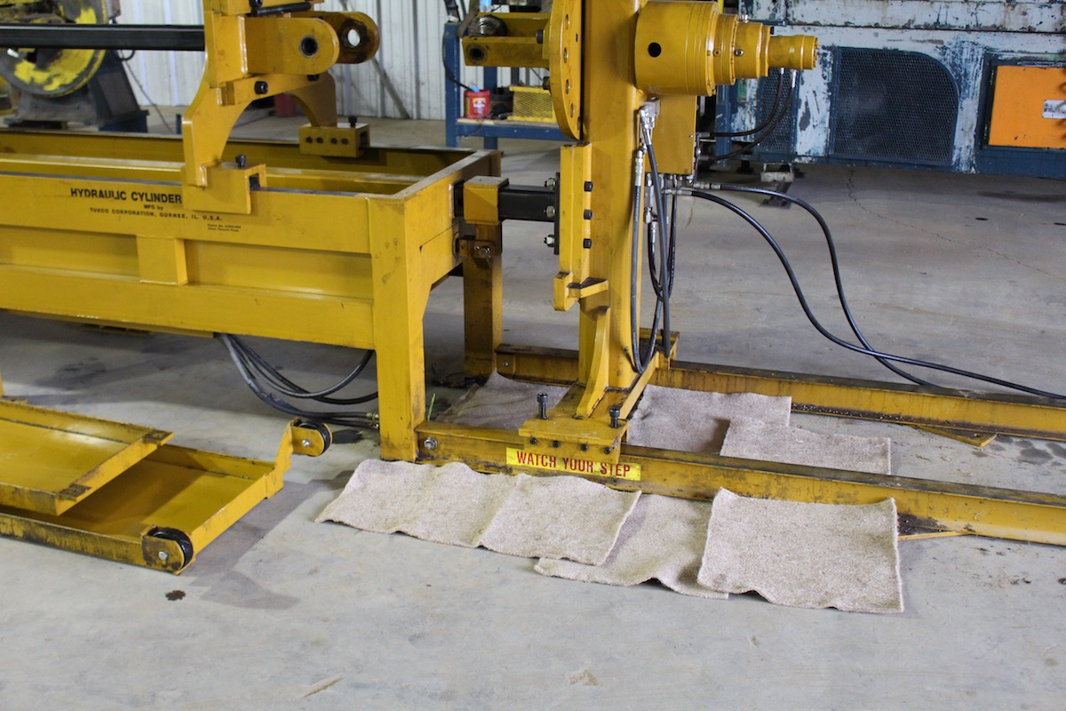 Kengro Biopad oil absorbent pad catching oil around steel shop machinery.