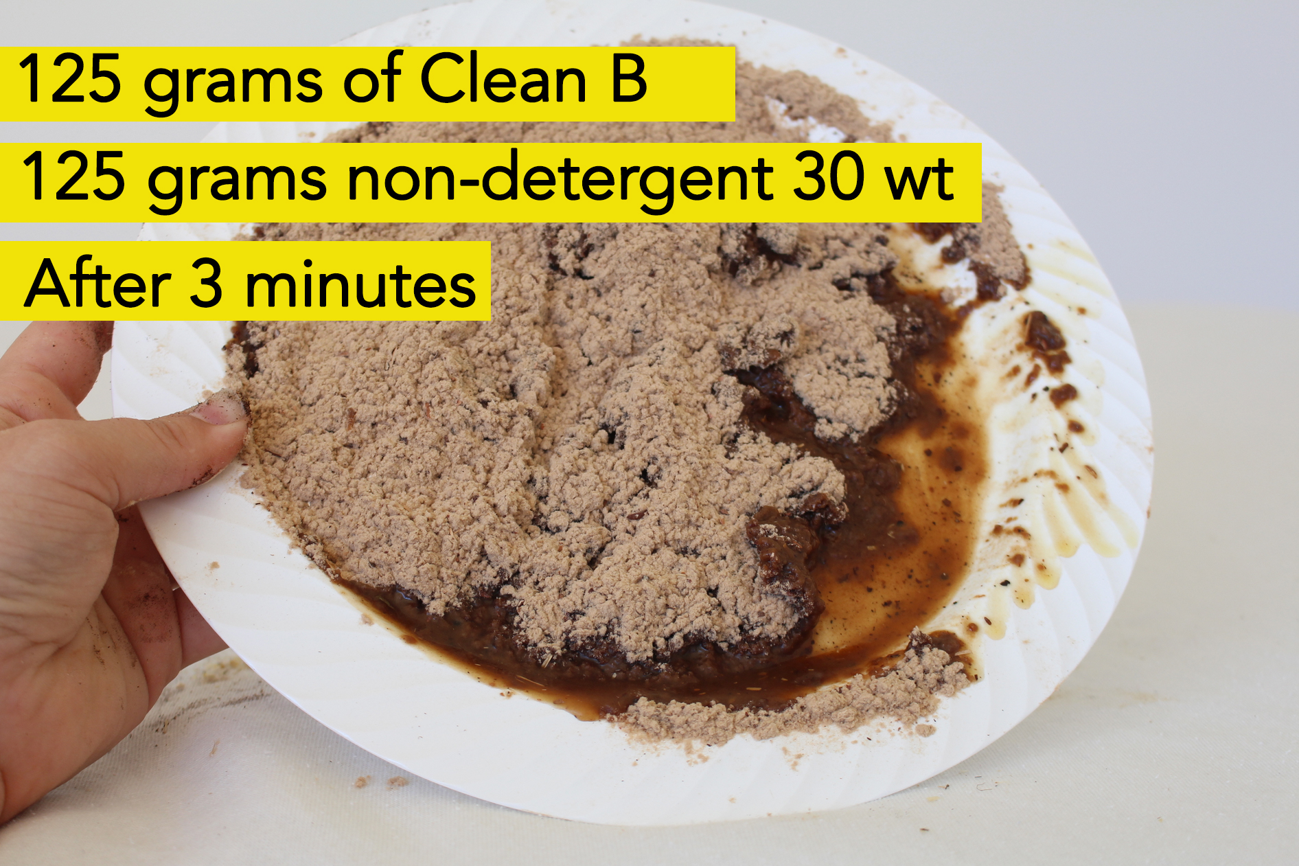 Clean B oil absorbent after cleaning up a minor oil spill test. Oil residue is still left over despite oil absorbent being used.