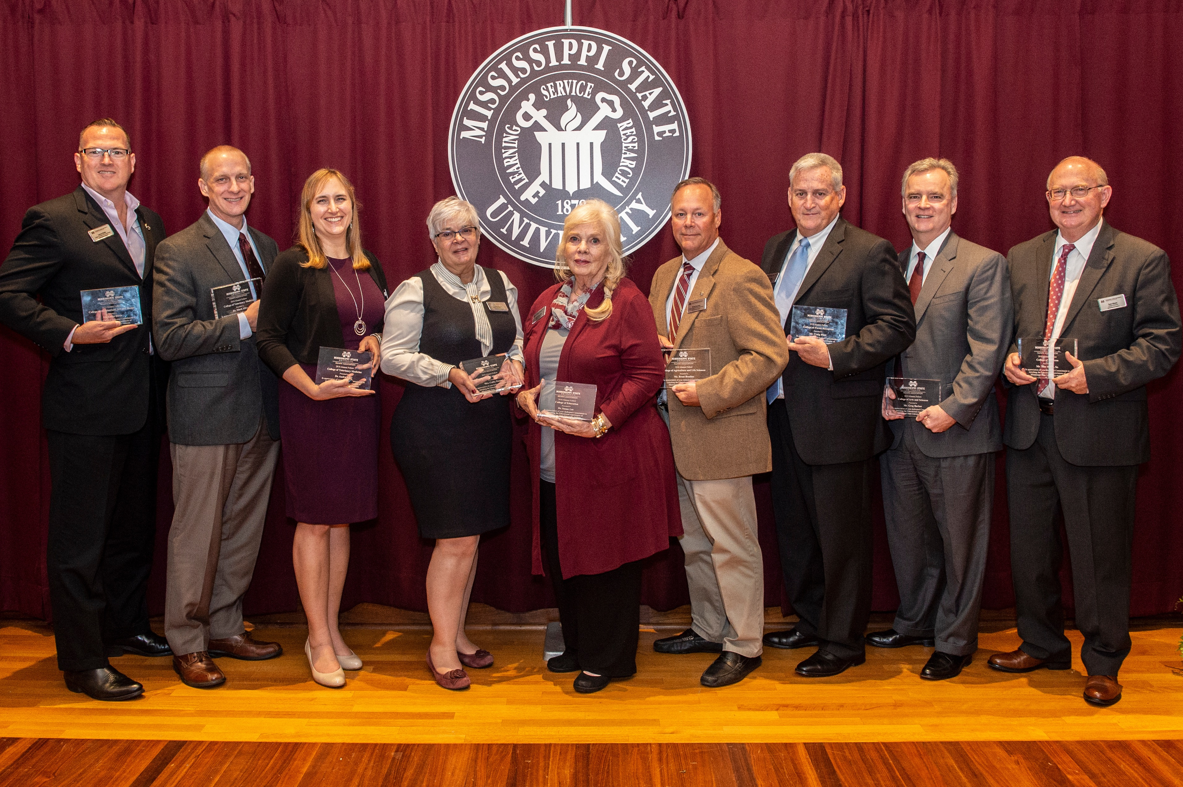 Mississippi State University's Alumni Fellows of the Year for 2019 stand with University President Mark Keenum.