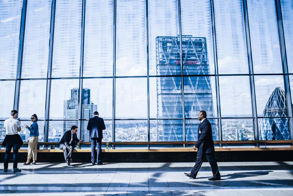 People in glass office London