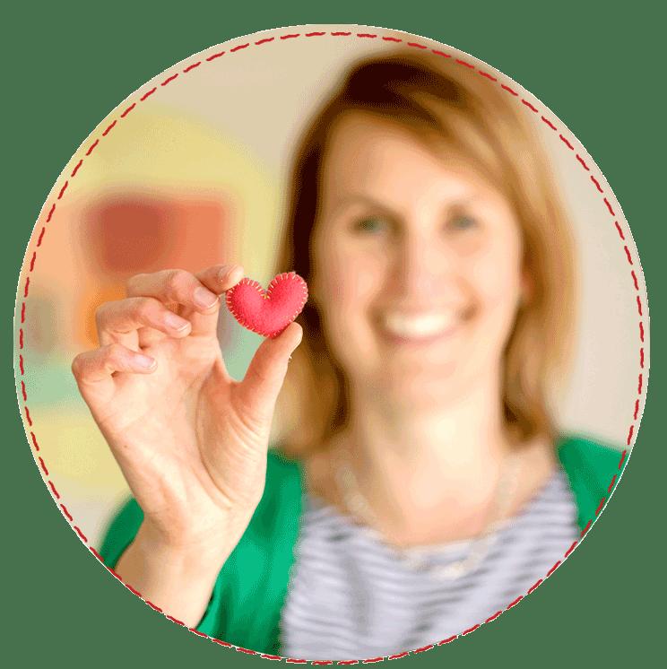 Sarah holding a heart
