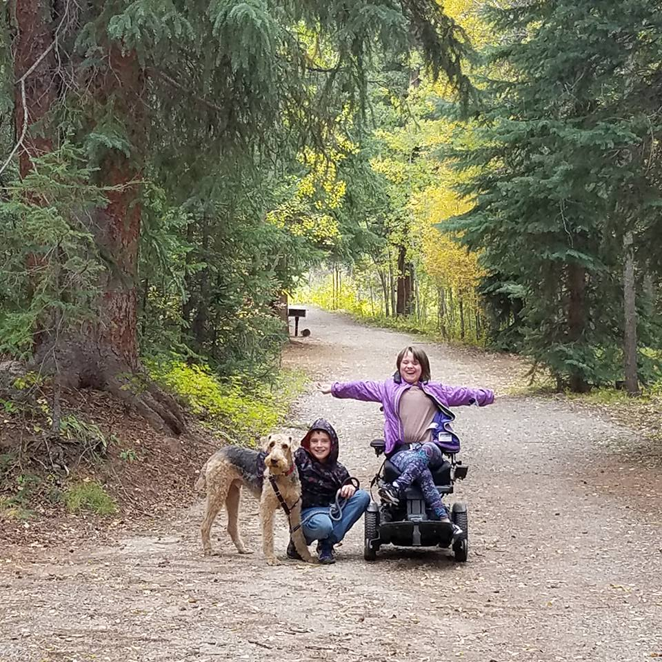 girl in motorized chair doing accessible hiking in Colorado at Wilderness on Wheels
