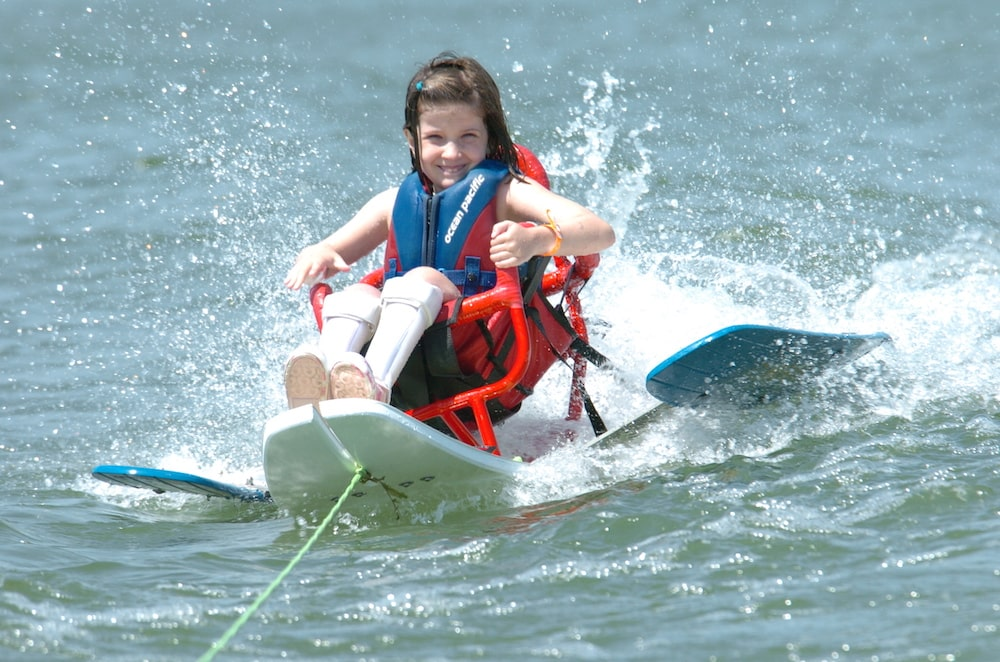 Girl in an adaptive wakeboard in Denver