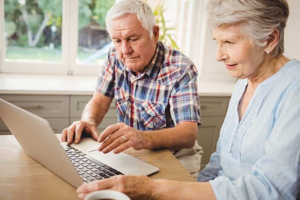 Senior couple using the computer to find hobbies and search the internet