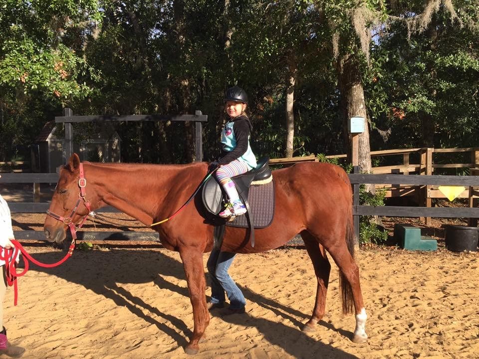 Girl with Cerebral Palsy taking horseback riding lessons at Whispering Meadows