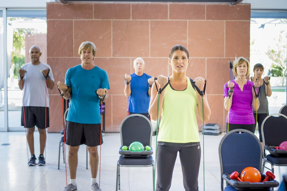 Group of people enjoying a free Silversneakers fitness class for seniors