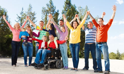 People with and without disabilities celebrating Disability Month