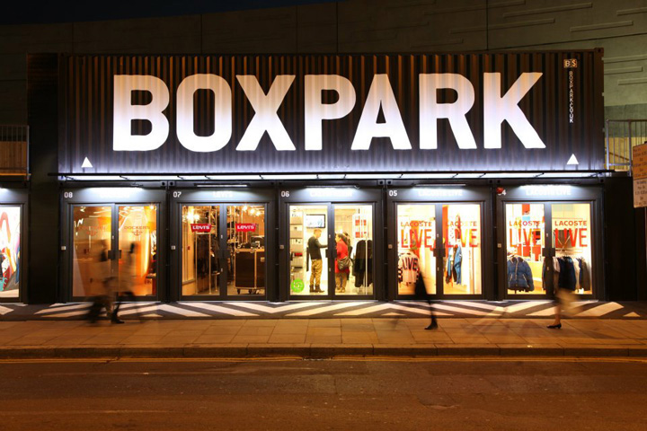 Retail sign that says Boxpark on a black shipping container