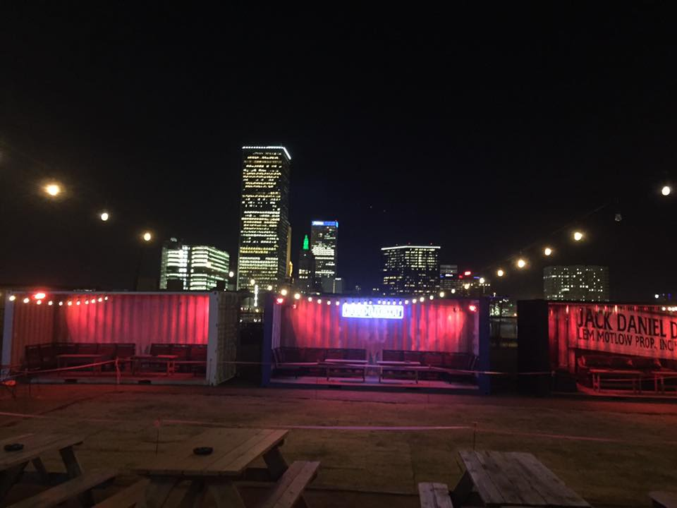 shipping containers being used as patio seating at a bar in downtown Tulsa