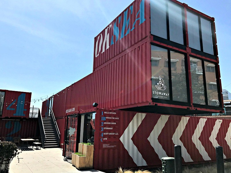Red shipping container park being used for retail stores