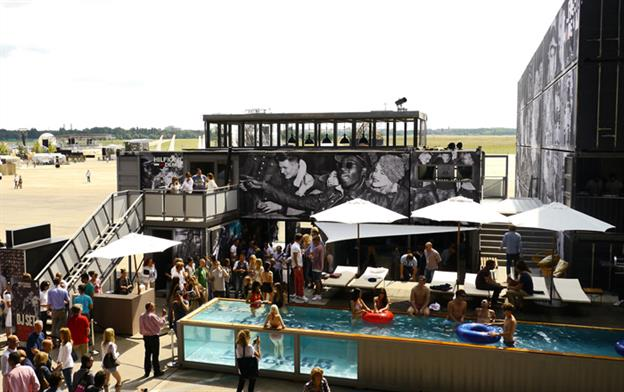 party location with a shipping container pool at the center