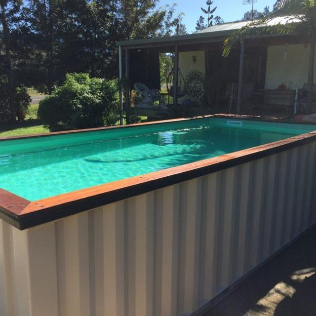 above ground pool made from a white shipping container