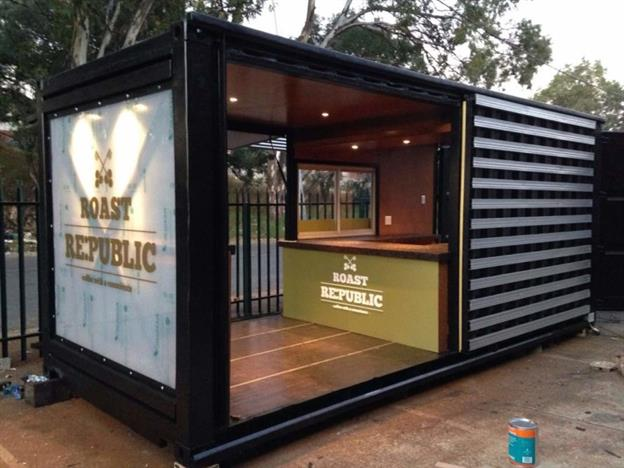 street side mobile coffee shop made from a black shipping container