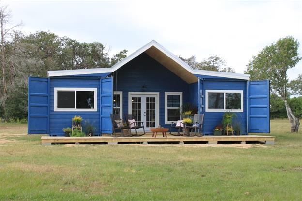 Farm style home made from blue shipping containers