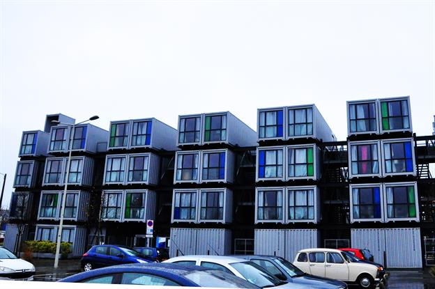 apartment complex made from white shipping containers