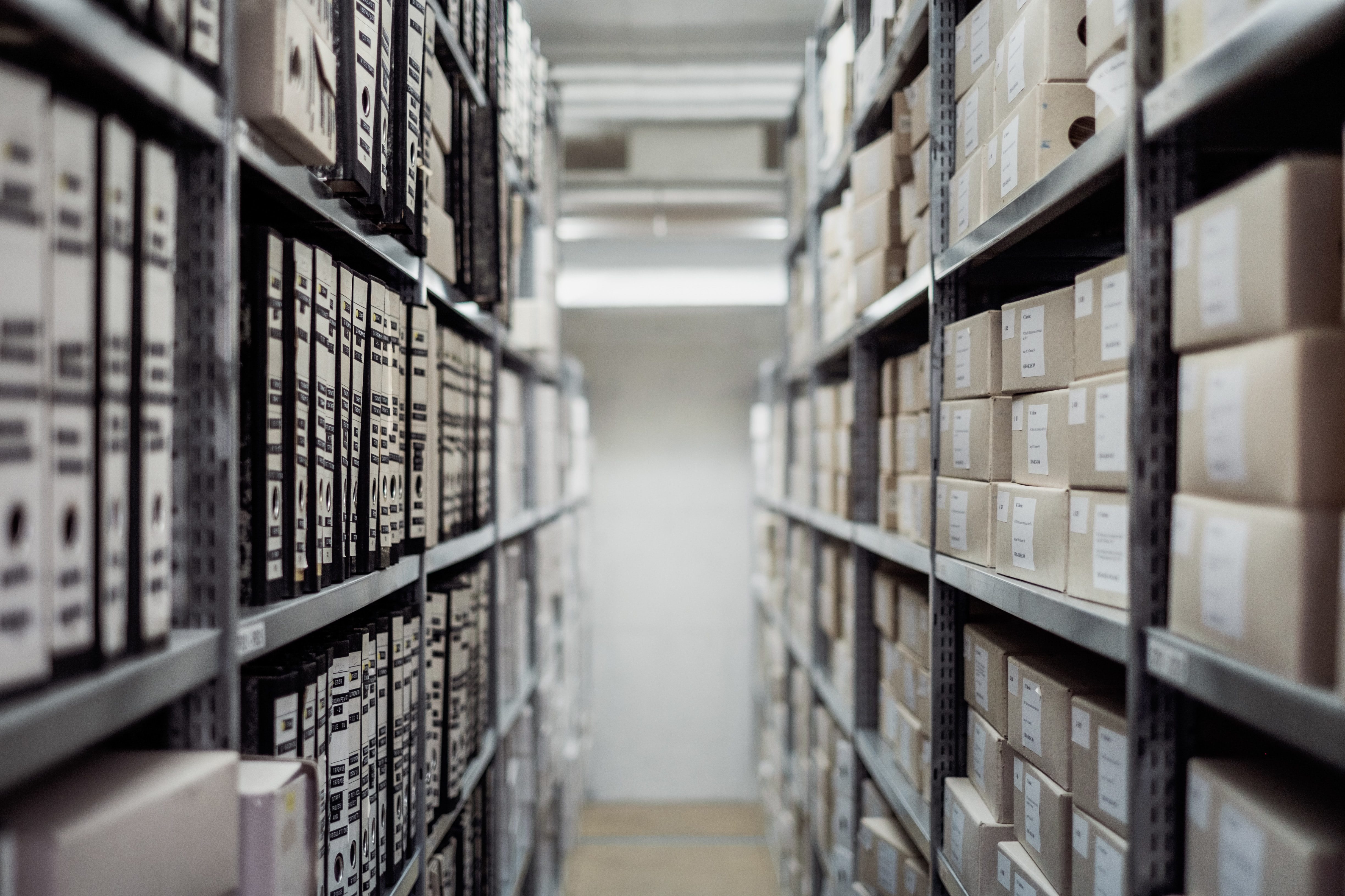 boxes on steel bracketed shelves