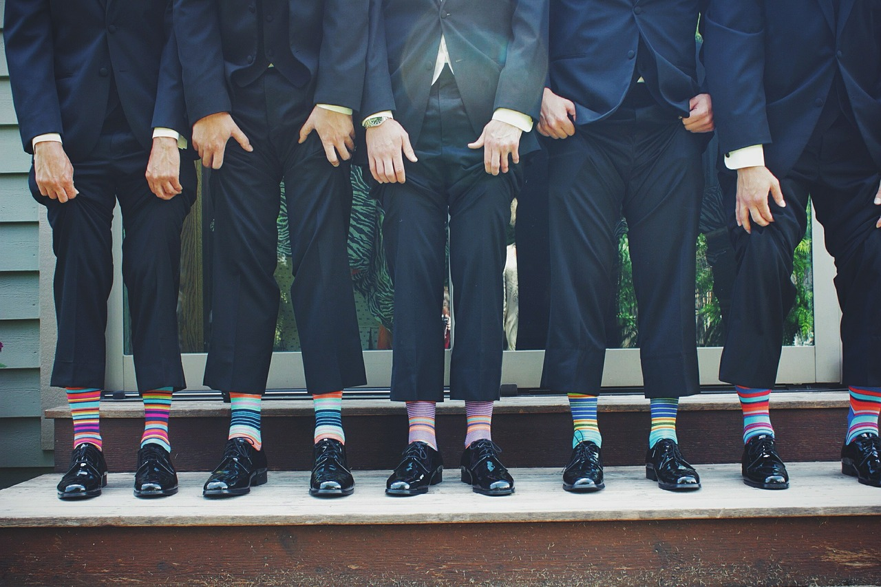 guys in suits wearing colourful socks