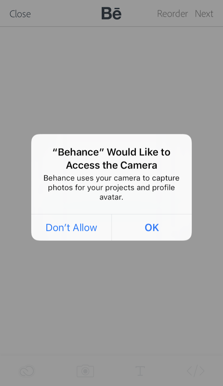This is a permission request from Behance mobile app. Behance uses the native request dialog modal window to ask for access to user's smartphone camera