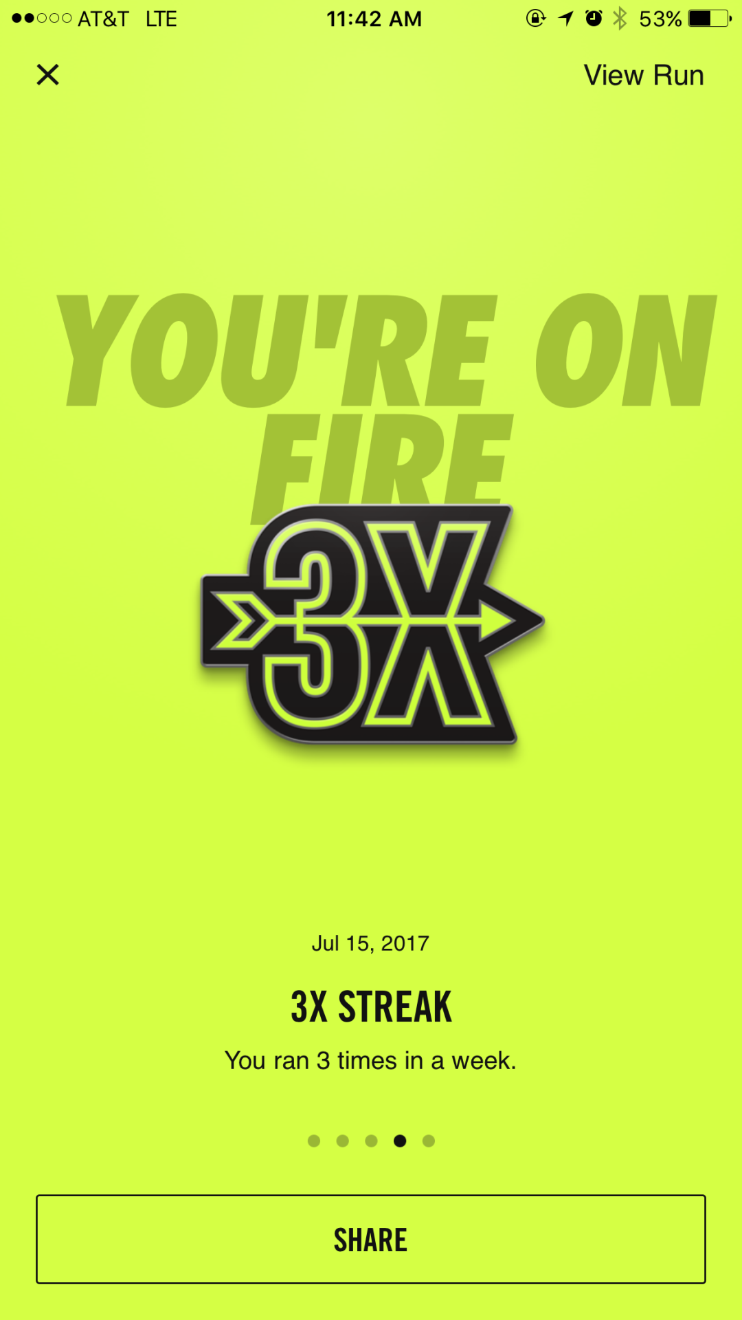 "this is a mobile screenshot image of the nike run club app. the screen is neon green and says: you're on fire 3x streak. there is a ""share"" call to action button at the bottom of the screen"