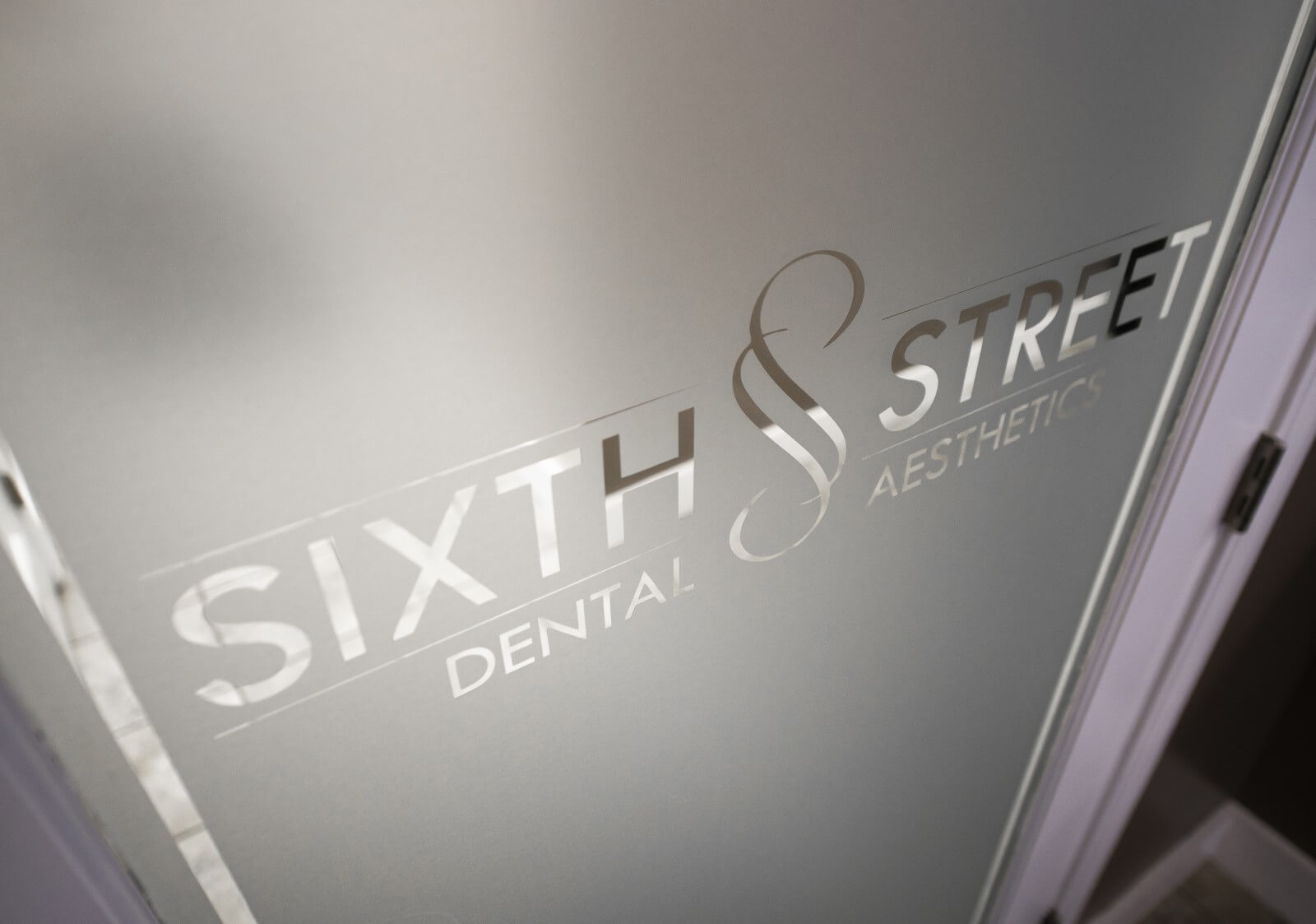 Sixtht Street Dental Logo