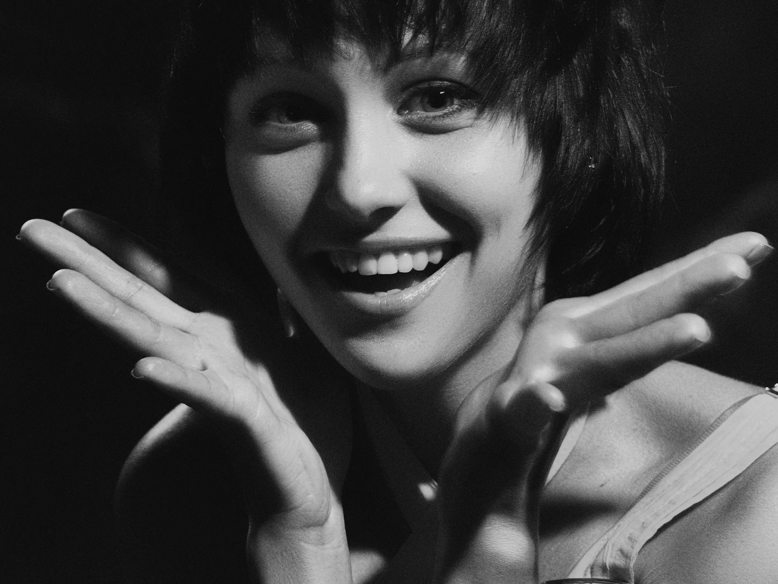 black and white photo of woman smiling