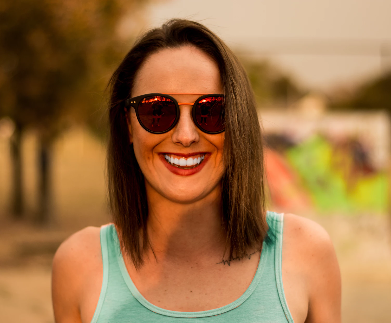 smiling woman sunglasses