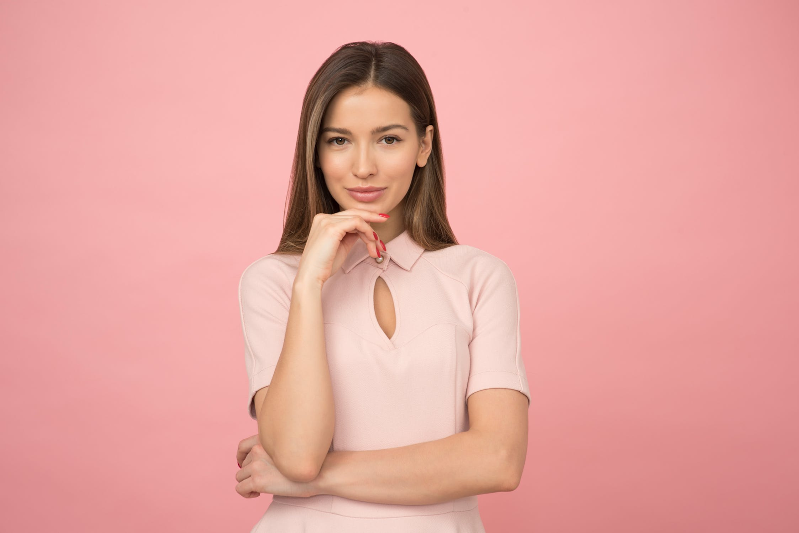 smiling woman pink background