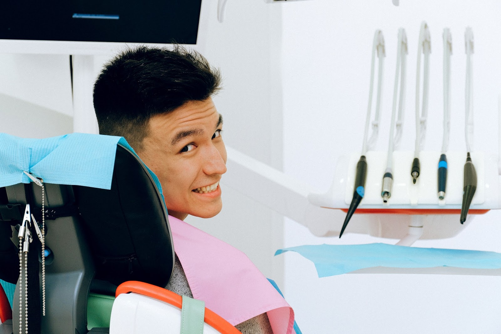 male dental patient in chair