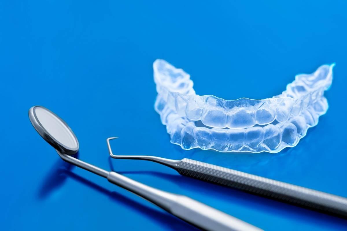 invisalign trays and dental tools