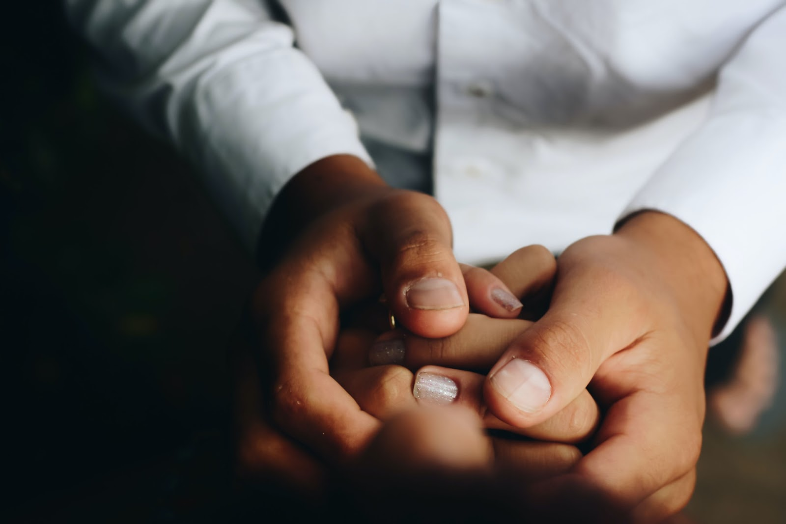 A guy holding a woman hand