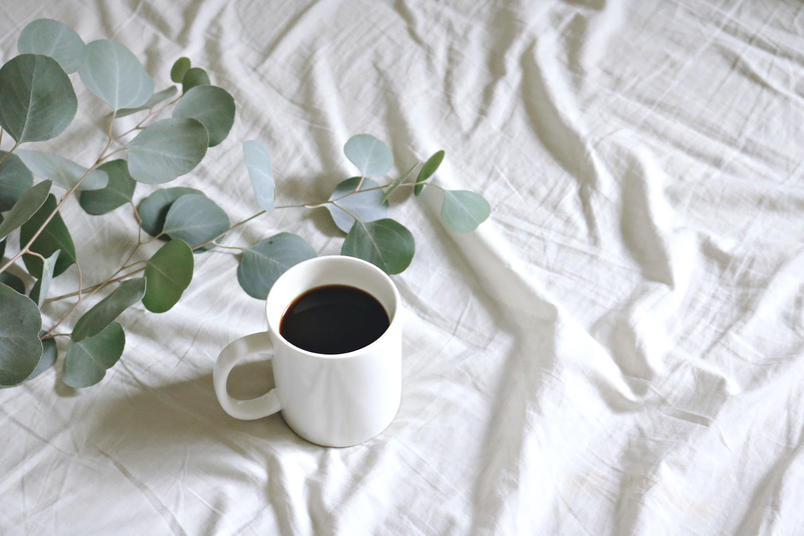 cup of coffee on bed