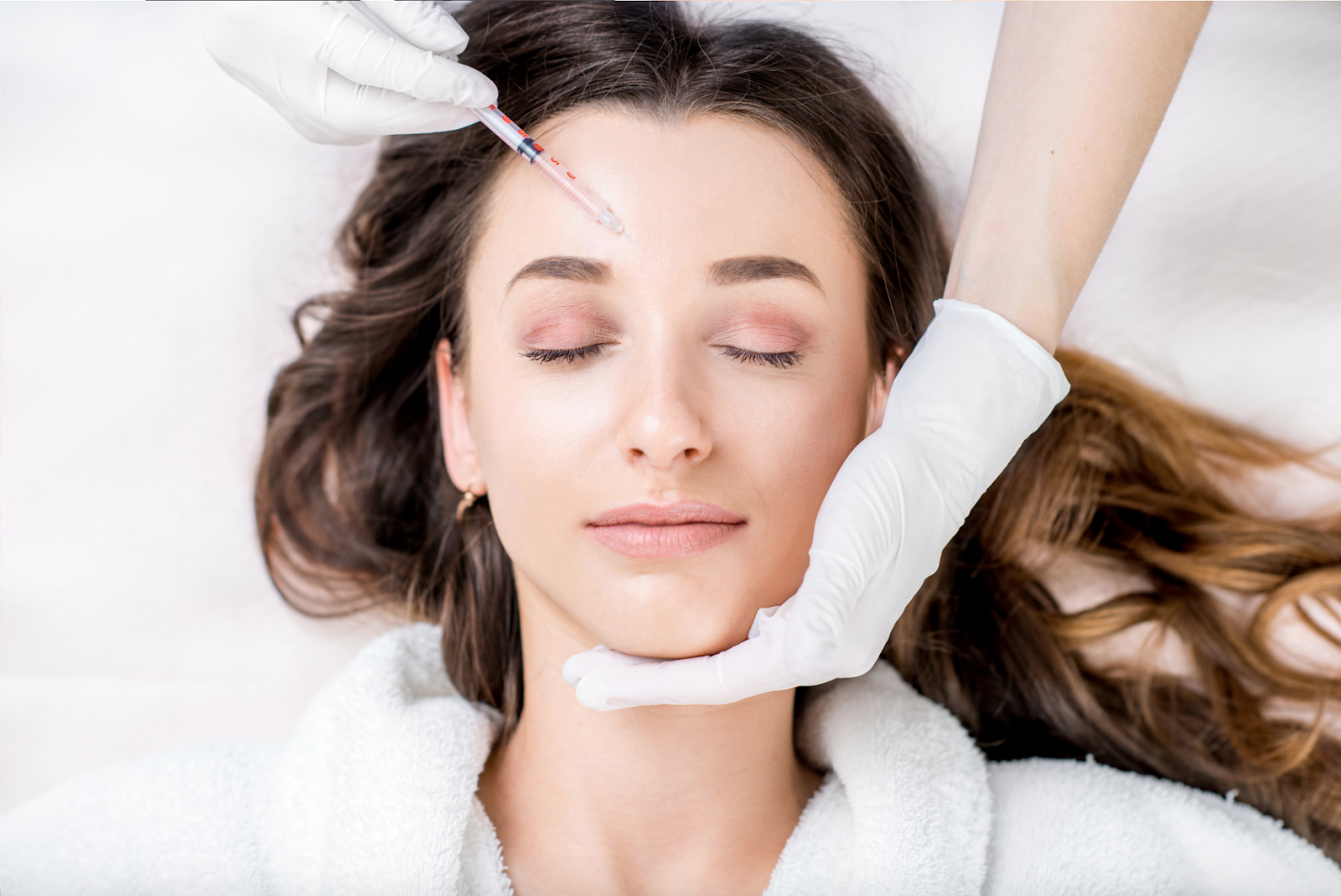 Woman getting botox treatment in forehead