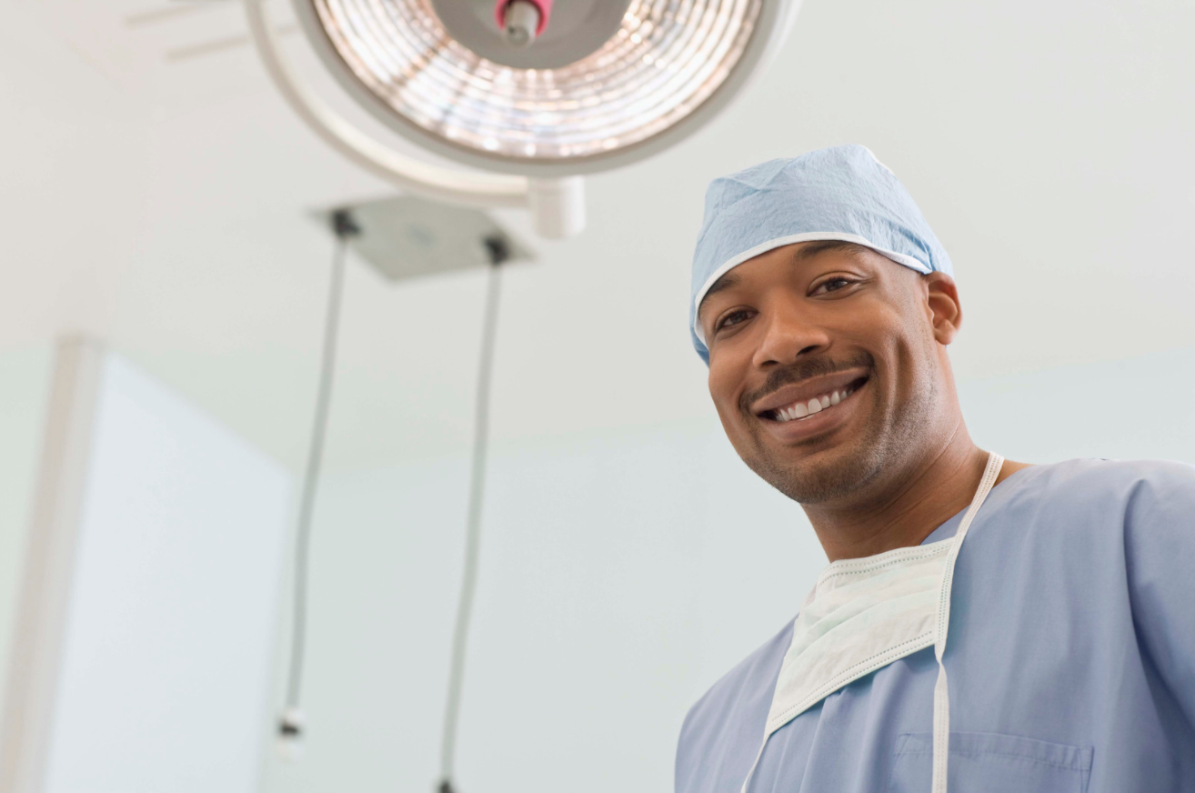 Surgeon in the operating room smiling at camera