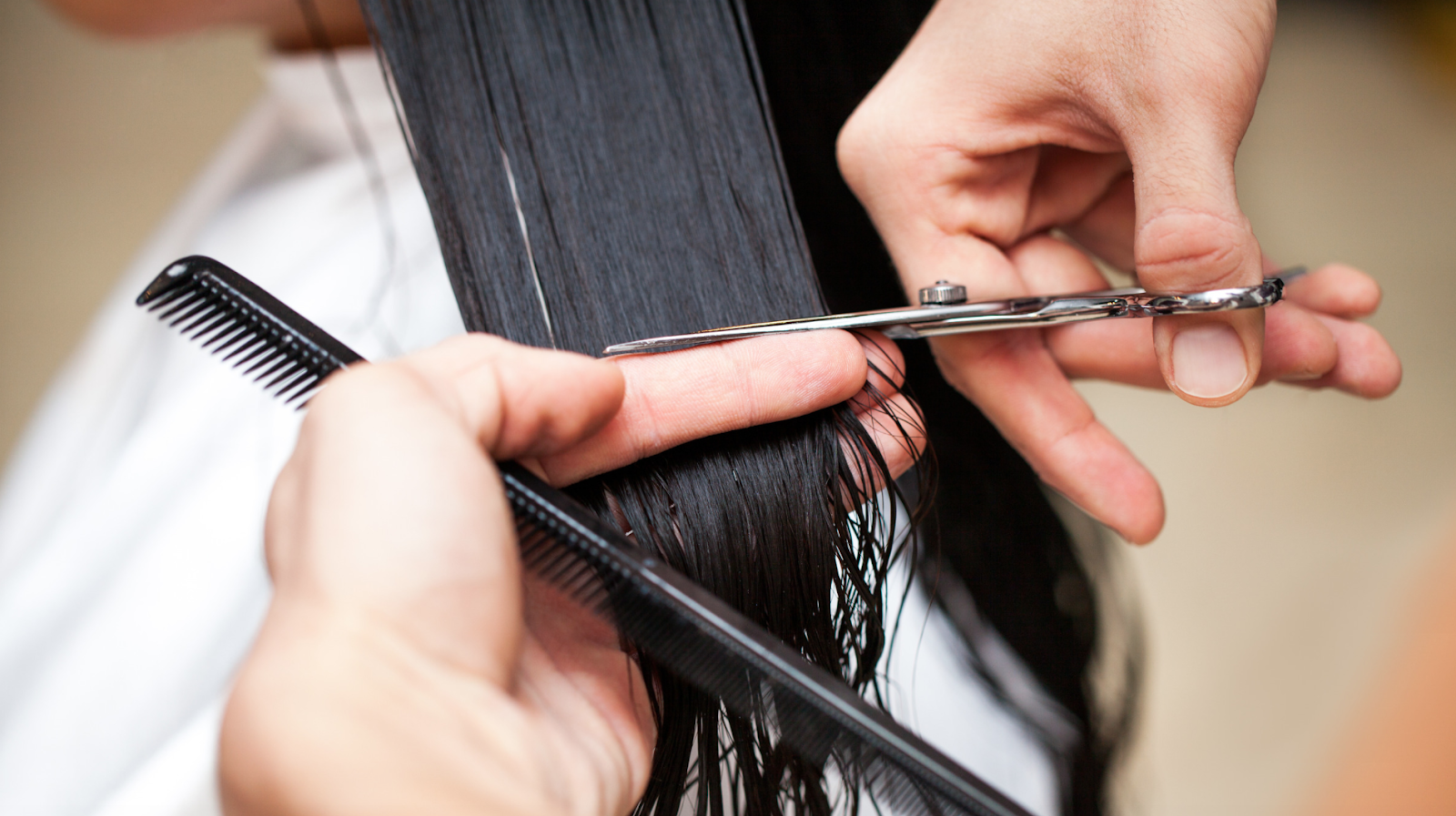 Closeup of long hair being cut