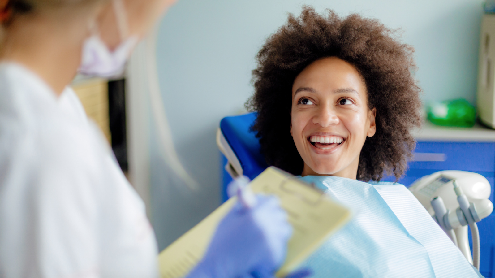 Women in dentists chair smiling