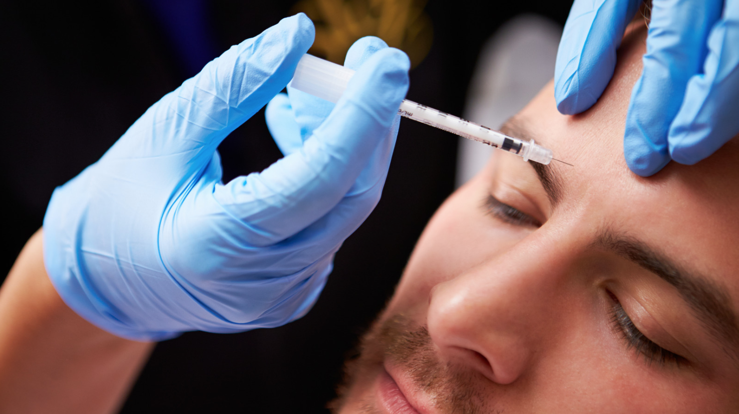 man getting Botox injection in eyebrow