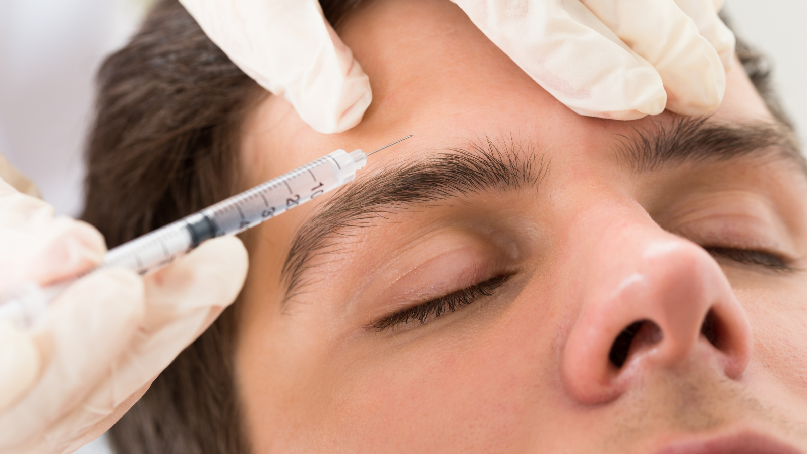 man getting Botox in eyebrow