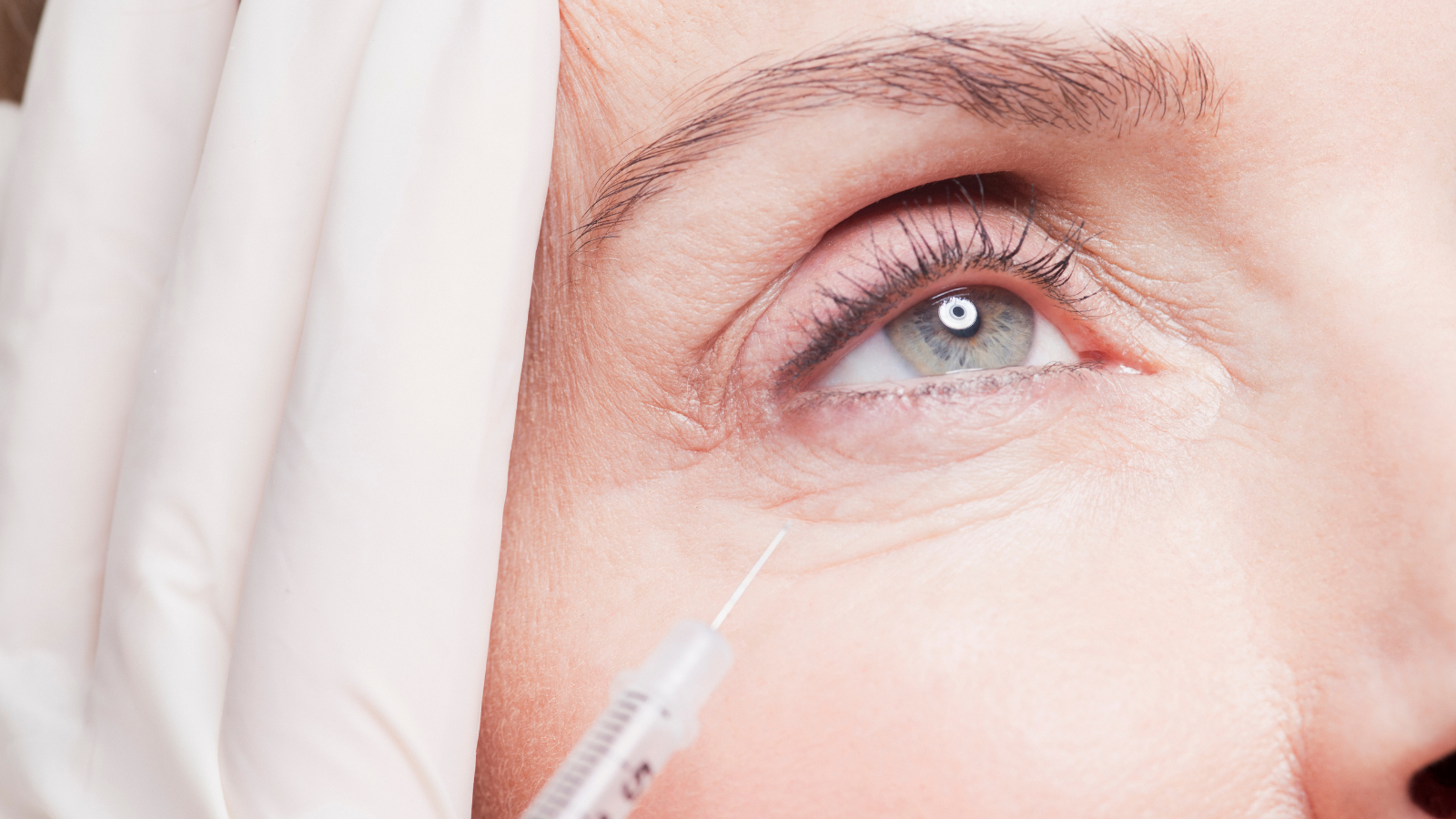 woman getting Botox to fix wrinkles under eyes