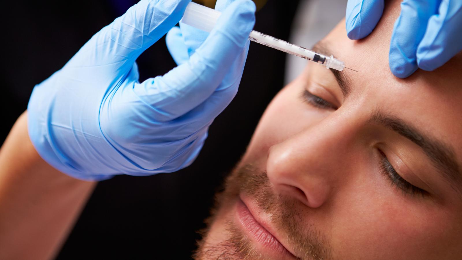 closeup of man getting Botox