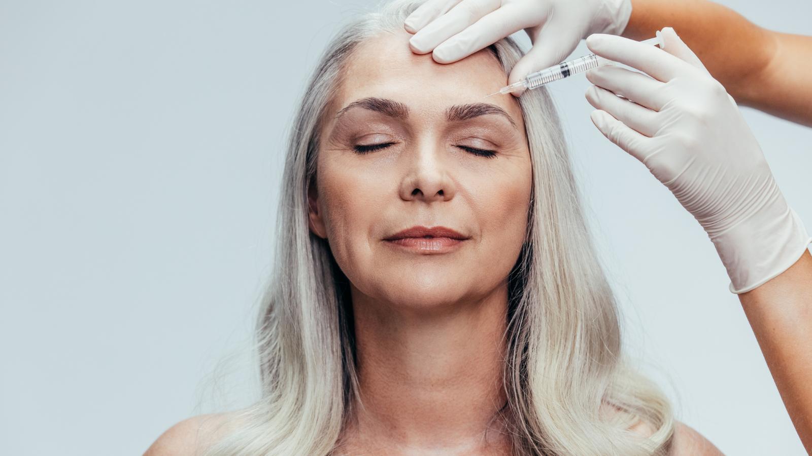 older woman getting Botox in eyebrow