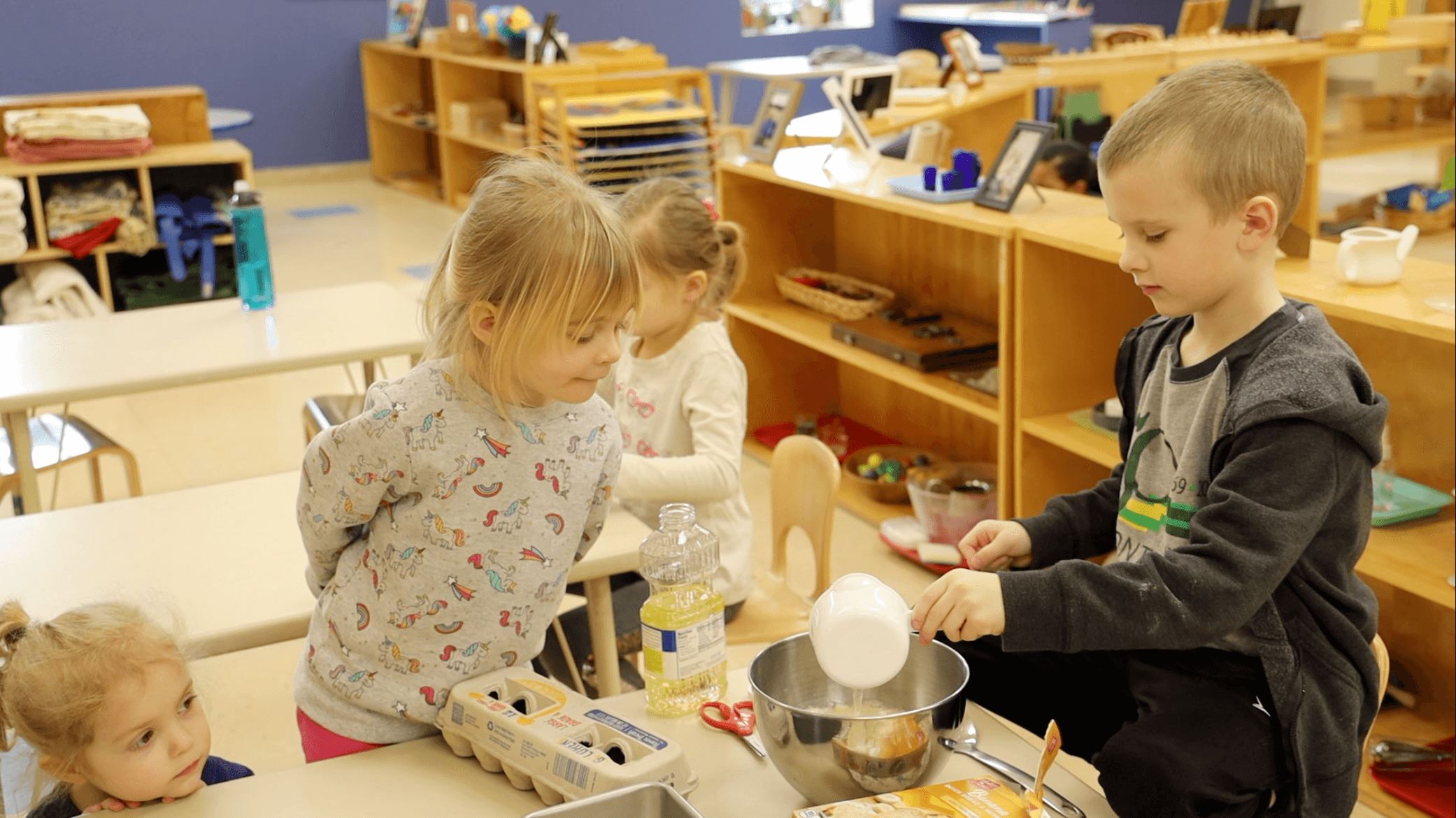 Kids playing with cooking materials