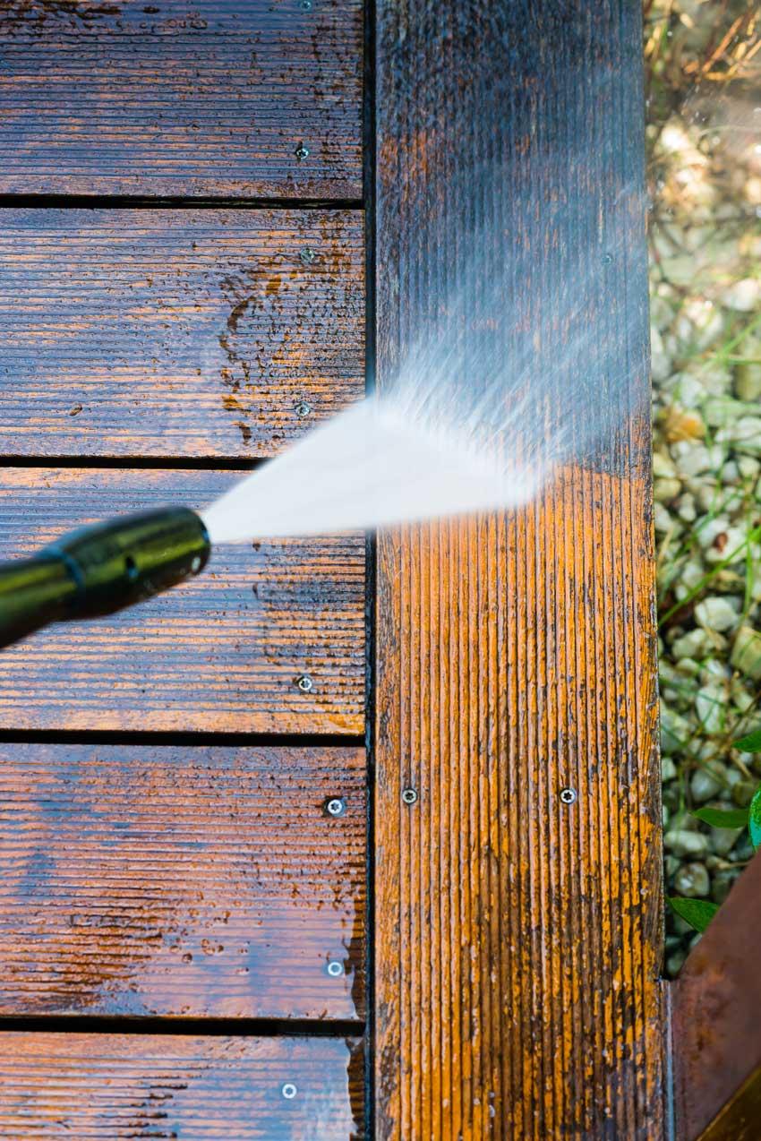 Pressure washing patio deck