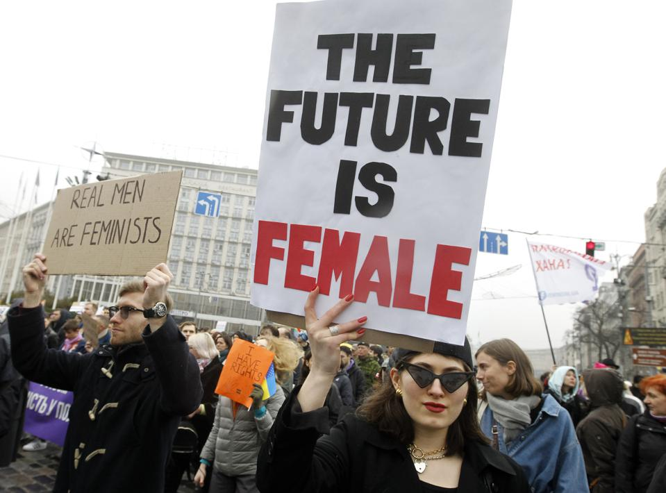 A woman holding a placard during the march with the slogan 'The future is female'.