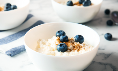 Three bowls of porridge to illustrate James Clear's Goldilocks Rule for establishing realistic fitness goals