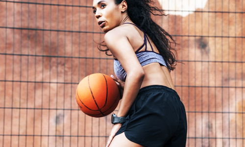 A woman plays basketball and incorporates the sport into her workout routine to make it enjoyable