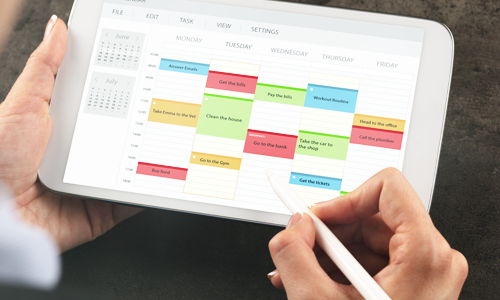 A woman adding personal training appointments to her calendar on her tablet